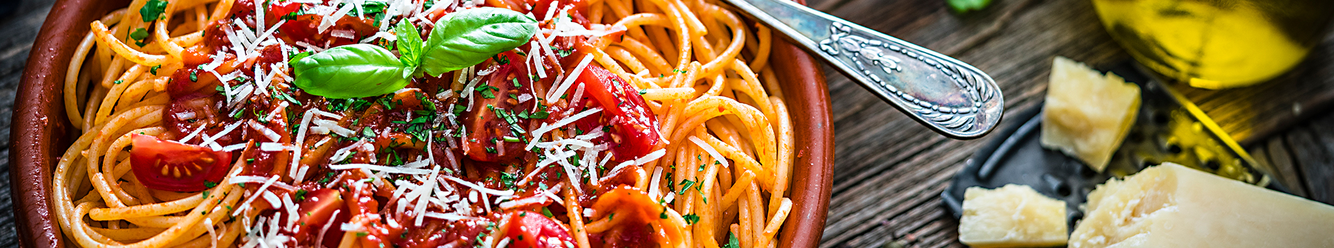 Bowl of Spaghetti with tomato sauce on rustic wooden table